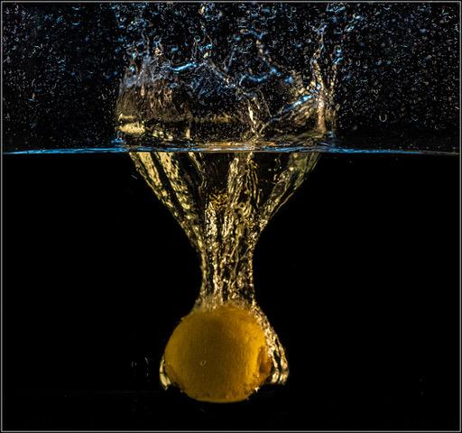 Dropping a lemon into a small fish tank